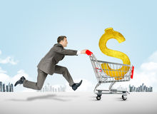 Running businessman with shopping cart Stock Image