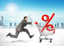 Running businessman with shopping cart Royalty Free Stock Image