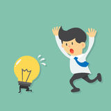 Running Businessman try to catch light bulb idea, light bulb escape from businessman by running Stock Images