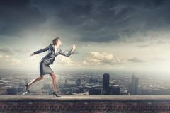 Running businesswoman Stock Photos