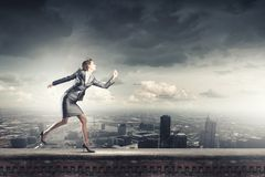 Running businesswoman Royalty Free Stock Photo