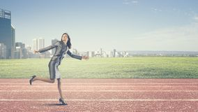 Running businesswoman stock photography