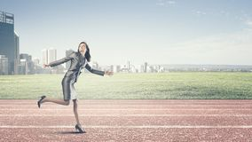 Running businesswoman Royalty Free Stock Image