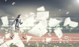 Running businesswoman Stock Images