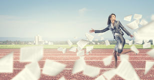 Running businesswoman Stock Photo