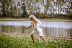 Free Running By The River Royalty Free Stock Image - 105729166