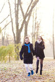 Running caucasian couple in forest Stock Photo