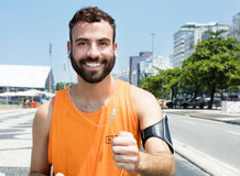 Running caucasian man with beard. In city with buildings in the background stock images