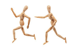 Running and chasing wood men Stock Photo