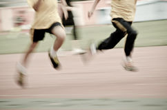 Running child on sport track royalty free stock photo
