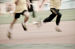 Running child on sport track Royalty Free Stock Photo