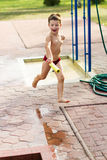 Running child with water cannon Royalty Free Stock Photo