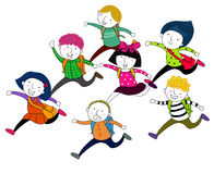 Running children with school bags Stock Image