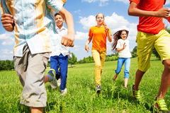 Running children together in motion outside Royalty Free Stock Photo