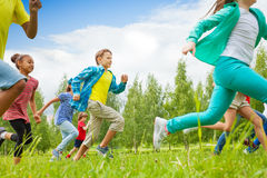 Running children view in the green field Royalty Free Stock Photo