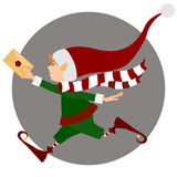 Running Christmas elf with letter  Stock Photos
