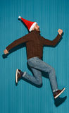 The running christmas man wearing a santa hat Stock Images