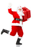 Running Christmas Santa Royalty Free Stock Photo