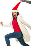 Running  Christmas woman is stopped by a hand Royalty Free Stock Photography