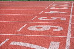 Running cinder track in the stadium. Place to start and finish the race. Perspective. Horizontal image royalty free stock image