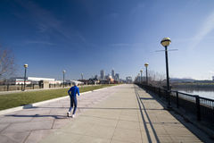 Running in the city. A senior is running on a bright sunny day with Indianapolis skyline in the background Stock Image