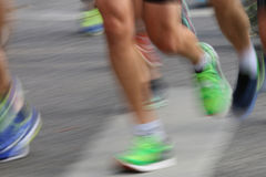Running colorful feet and legs Stock Images