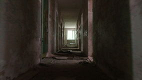 Running in the corridor in the abandoned house. Smooth and slow steady cam shot