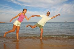 Running couple on beach Stock Image