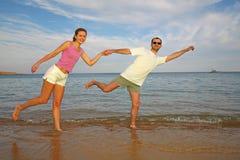 Running couple on beach. At sea Stock Image