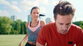 Running couple catching a short break. Handheld view of running couple catching a short break stock video footage