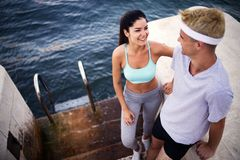 Runners training together. Man and woman joggers exercising outdoors. royalty free stock image