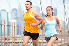 Running couple jogging in New York City Stock Images