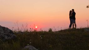 Running couple in love at sunset stock video footage
