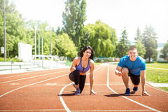 Running couple outdoors. Royalty Free Stock Images