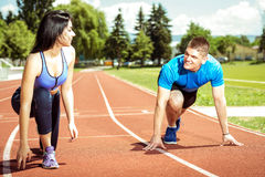 Running couple outdoors. Royalty Free Stock Photography