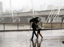Running couple in the rain Stock Photo