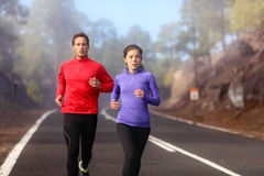 Running couple training cardio in cold nature Royalty Free Stock Photos