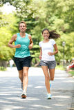 Running couple training outdoors in park fit happy Stock Photos