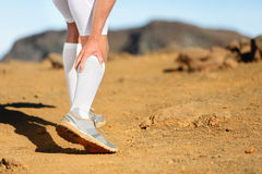 Running Cramps in leg calves sprain calf on runner. Running Cramps in leg calves or sprain calf on runner. Sports injury concept with running fitness man athlete Royalty Free Stock Image