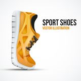 Running curved orange shoes. Bright Sport sneakers Stock Photos