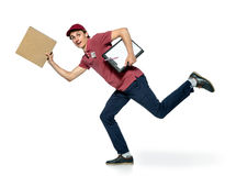 Running delivery postman with box. Royalty Free Stock Image