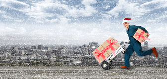 Running Delivery postman. Happy Running Delivery postman with Christmas presents Royalty Free Stock Photo
