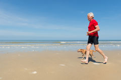 Running with dog at the beach Stock Photos