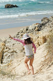 Running down the dune. Child excitedly running down the dune towards the ocean Stock Images