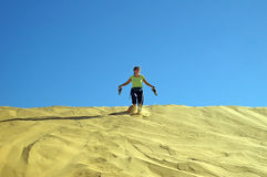 Running down the dune Royalty Free Stock Image