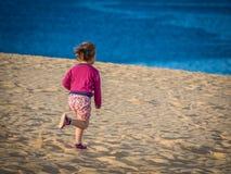Running down the sand dunes Stock Photo