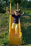 Running Down the Slide Stock Photos