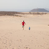 Running in dunes Royalty Free Stock Images