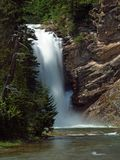 Running Eagle Falls #1. This image of the waterfall was taken in the Two Medicine area of Glacier National Park, Montana Stock Image