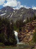 Running Eagle Falls. This image of the waterfall and mountains was taken in the Two Medicine area of Glacier National Park, Montana Stock Photo